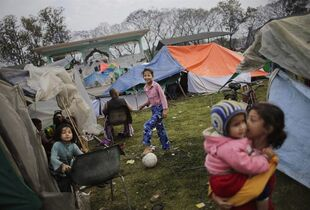 Survivors of Saturday's earthquake play outside their tent at a makeshift camp in Kathmandu, Nepal, Tuesday, April 28, 2015. A strong earthquake shook Nepal�€™s capital and the densely populated Kathmandu valley on Saturday. THE CANADIAN PRESS/AP, Altaf Qadri