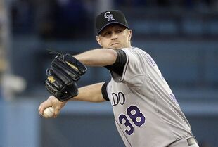 Colorado Rockies starting pitcher Kyle Kendrick throws against the Los Angeles Dodgers during the first inning of a baseball game, Friday, April 17, 2015, in Los Angeles. (AP Photo/Jae C. Hong)