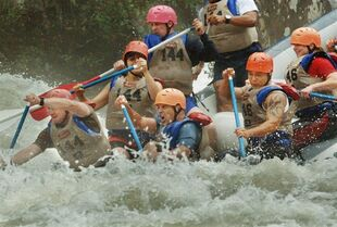 FILE - This Friday Oct. 6, 2006, file photo, shows members of the military race down the Gauley River during the sixth annual Wilderness Challenge adventure race in Summersville, W.Va. West Virginia whitewater industry official blames chemical spill in part for drop in bookings. (AP Photo/Jeff Gentner)