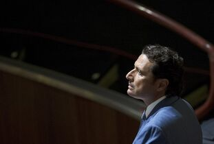 FILE -- In this file photo taken on Sept. 24, 2013 Captain Francesco Schettino waits for the arrival of the judges in the court room of the converted Teatro Moderno theater at the end of a pause of his trial, in Grosseto, Italy. A prosecutor in the trial for the shipwreck of the Costa Concordia contends that 32 people died not because the luxury cruise liner crashed into a reef, but due to