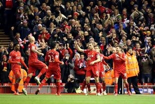 Liverpool's Jordan Henderson, center right, celebrates scoring his side's first goal of the game with his teammates during their English Premier League soccer match against Burnley at Anfield, Liverpool, England, Wednesday, March 4, 2015. (AP Photo/Peter Byrne, PA Wire) UNITED KINGDOM OUT - NO SALES - NO ARCHIVES