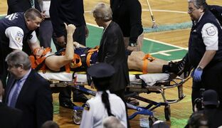 In this Jan. 3, 2014, file photo, New Orleans Pelicans forward Ryan Anderson flashes a thumb-up while being taken off the court on a stretcher following an injury during the second half of an NBA basketball game against the Boston Celtics in Boston. Anderson hasn't played since a hard collision with Celtics' Gerald Wallace left Anderson with a herniated disk in his neck. He had surgery in April and recently has been cleared by doctors to play without restrictions. He expects to participate fully in training camp which begins Sept. 30. (AP Photo/Charles Krupa, File)