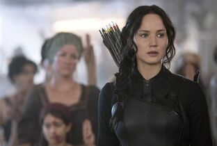 In this image released by Lionsgate, Jennifer Lawrence portrays Katniss Everdeen in a scene from