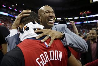 New Orleans Pelicans head coach Monty Williams celebrates with guard Eric Gordon after their NBA basketball game victory over the San Antonio Spurs in New Orleans, Wednesday, April 15, 2015. The Pelicans won 108-103 to lock up the final playoff slot in the Western Conference. (AP Photo/Gerald Herbert)