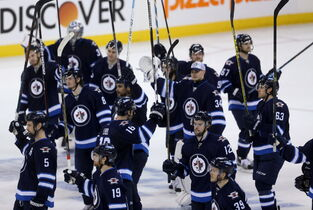 The Winnipeg Jets' salute the crowd after losing to the Anaheim Ducks.
