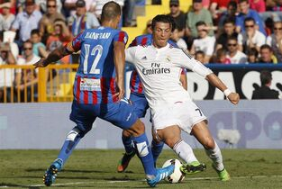 Real Madrid's Cristiano Ronaldo, right, from Portugal duels for the ball with Levante's JuanFran Garcia during a Spanish La Liga soccer match at the Ciutat de Valencia stadium in Valencia, Spain, on Saturday, Oct. 18, 2014.(AP Photo/Alberto Saiz)