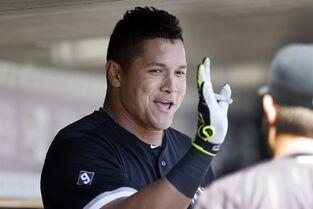 Chicago White Sox's Avisail Garcia celebrates his solo home run with a teammate during the second inning of a baseball game against the Detroit Tigers, Friday, April 17, 2015, in Detroit. (AP Photo/Carlos Osorio)