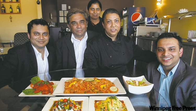 From left, Pinky Singh, Narmin Biswas, Rashid Islam, Rana Biswas and Antu Biswas at Water Lily East Indian Restaurant.