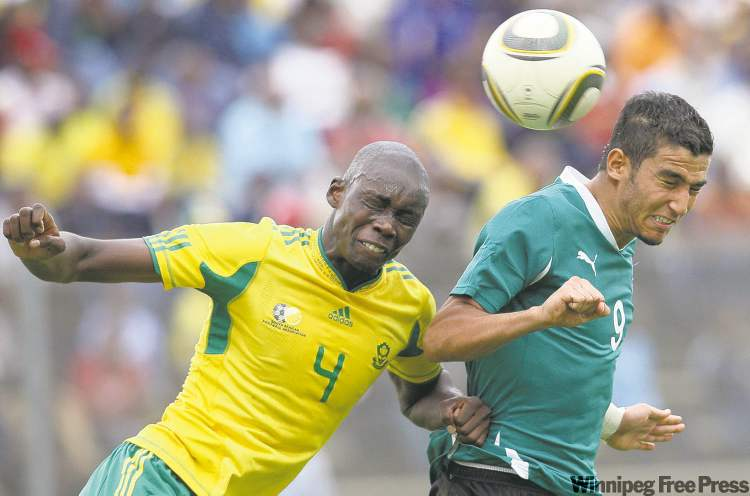 South Africa's Mulomowandou Mathoho (left) and Liby'a Mohamed Ghanudi face off in an Olympic qualifying soccer game between the two long-standing rival teams.