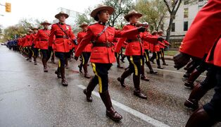 RCMP and other Police officers march down Broadway towards the Legislative Building, Sunday, Sept. 28.