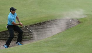 Sergio Garcia of Spain fails to hit out of a bunker on the 15th hole during the final round of the British Open Golf championship at the Royal Liverpool golf club, Hoylake, England, Sunday July 20, 2014. (AP Photo/Scott Heppell)