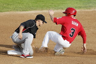 Winnipeg Goldeyes' Tyler Kuhn is tagged out attempting to steal second Tuesday night.