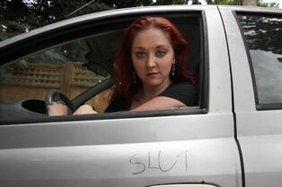 Theresa Thomson inside her car that was defaced recently, part of the intimidation the actress has faced over the play Lies of a Promiscuous Woman that some have blasted as blasphemous.