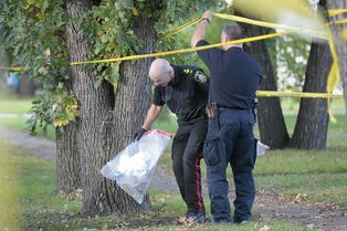 Police collect evidence at 98 Hill St. in St Boniface, the scene of Winnipeg's latest slaying.