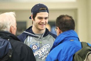 Winnipeg Jets' Adam Lowry talks to fans before practice this morning. At the press conference after practice, head coach Maurice made cracks about the power-play unit's ineptitude. Winnipeg has now gone five games without a power-play goal, a stretch of 18 chances.