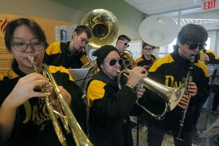 The Dakota Collegiate pep band entertains during the school division's annual donation drop-off event Thursday.  Front, from left: Wendy Jung, Adriana Rodas and Dylan Ondracek.