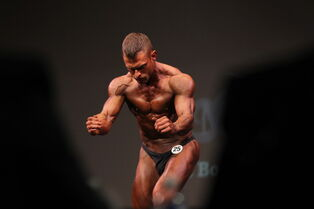 Mathew Harasym competes in the Mens Bodybuilding lightweight category.