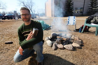Steve Heinrichs builds a fire and prays outside Canadian Mennonite University every day between Easter and Earth Day to bring attention to climate change issues.