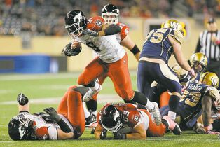 Calgary Stampeders running back Jon Cornish (9) went through the Bombers defence with the greatest of ease Saturday night.