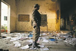 Shrapnel, pools of blood and personal belongings litter the floor at the school in Peshawar, Pakistan where the Taliban killed 149 people.  where Taliban gunmen killed 145 people, many of them children, the day before. Empty bullet casings, pools of blood and personal belongings littered the floors and shrapnel and bullet holes lines the walls. Illustrates PAKISTAN (category i), by Tim Craig (c) 2014, The Washington Post. Moved Friday, Dec. 26, 2014. (MUST CREDIT: Photo for The Washington Post by)