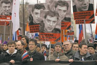 Pavel Golovkin / The Associated Press