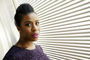 In this Tuesday, July 22, 2014 photo, actress Uzo Aduba, a cast member in the Netflix series