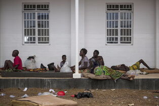 Ebola patients lie outside Port Loko District Hospital in Port Loko, Sierra Leone earlier this month.