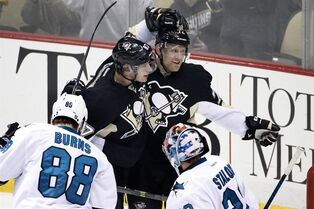 Pittsburgh Penguins' Patric Hornqvist, center, celebrates his goal in the first period with teammate Sidney Crosby (87) during an NHL hockey game against the San Jose Sharks in Pittsburgh on Sunday, March 29, 2015.When it comes to scoring, Sid the Kid's pace this season is no match for the greatest by the Great One.Pittsburgh forward Crosby is in line to win the scoring title with what can be projected to be about 85 points. THE CANADIAN PRESS/AP/Gene J. Puskar