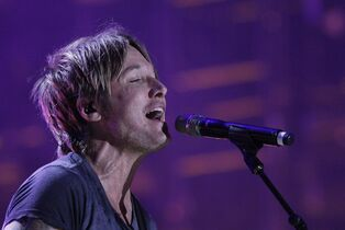 Keith Urban performs on June 7, 2014, in Nashville, Tenn. THE CANADIAN PRESS/AP, Wade Payne/Invision