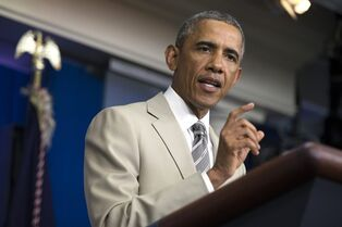 President Barack Obama gestures in the James Brady Press Briefing Room of the White House in Washington, Thursday, Aug. 28, 2014, where he spoke about the economy, Iraq, and Ukraine, before convening a meeting with his national security team on the militant threat in Syria and Iraq. (AP Photo/Evan Vucci)