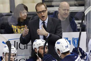 Winnipeg Jets coach Paul Maurice talks to his players during the third period of an NHL hockey game against the Pittsburgh Penguins in Pittsburgh on Tuesday, Jan. 27, 2015. The Penguins won 5-3.
