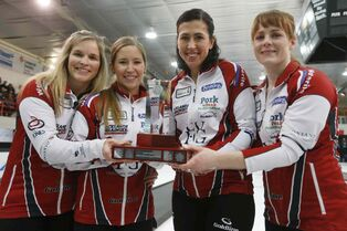 Jennifer Jones, Kaitlyn Laews, Jill OFficer and Dawn McEwen (from left) celebrate winning the Manitoba title, beating Kerri Einarson Sunday.