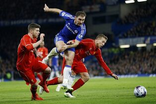 Chelsea's Branislav Ivanovic, center, battles for the ball between Liverpool's Alberto Moreno and Lucas Leiva, right, during the English League Cup semifinal second leg soccer match between Chelsea and Liverpool at Stamford Bridge stadium in London, Tuesday, Jan. 27, 2015. (AP Photo/Alastair Grant)