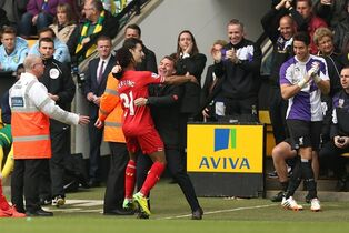 Liverpool's Raheem Sterling celebrates scoring the opening goal of the game with his manager Brendan Rodgers during their English Premier League match against Norwich City at Carrow Road, Norwich, eastern England, Sunday April 20, 2014. (AP Photo/PA, Chris Radburn) UNITED KINGDOM OUT NO SALES NO ARCHIVE