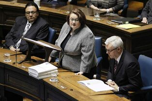 Manitoba Finance Minister Jennifer Howard reads the provincial budget as minister Eric Robinson (left) and Premier Greg Selinger listen in at the Manitoba Legislature.