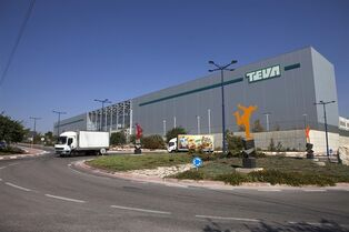 FILE - In this Oct. 16, 2013 file photo, trucks run past Teva Pharmaceutical Logistic Center in the town of Shoam, Israel. On Tuesday, April 21, 2015, Teva has offered to buy Mylan for about $40.1 billion in cash and stock in a deal that would create a powerhouse of generic drug development. (AP Photo/Dan Balilty, File)