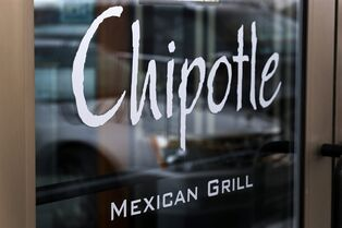 FILE - This Tuesday, Jan. 28, 2014 file photo shows the door of a Chipotle Mexican Grill in Robinson Township, Pa. Chipotle on Monday, April 27, 2015 said it has completed phasing out genetically modified ingredients from its food, making it the first national fast-food chain to do so. (AP Photo/Gene J. Puskar, File)