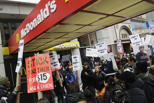 FILE - In this March 17, 2015 file photo, dozens of fast food workers and their supporters protest workplace conditions in front of a McDonald's restaurant, in New York. Fast-food labor organizers say they're expanding the scope of their campaign for $15 an hour and unionization, this time with a day of actions including college campuses and workers from other low-wage industries. (AP Photo/Mark Lennihan, File)