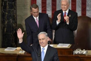 Israeli Prime Minister Benjamin Netanyahu waves as he speaks before a joint meeting of Congress on Capitol Hill in Washington, Tuesday.