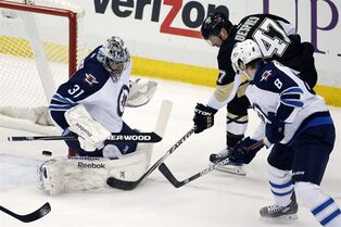 Pittsburgh Penguins' Simon Despres (47) can't get a shot past Winnipeg Jets goalie Ondrej Pavelec (31) with Jacob Trouba (8) defending during the first period of an NHL hockey game in Pittsburgh on Tuesday, Jan. 27, 2015.(AP Photo/Gene J. Puskar)
