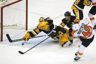 Philadelphia Flyers' Vincent Lecavalier (40) gets a shot under the stick of Pittsburgh Penguins goalie Marc-Andre Fleury (29) for a goal in the first period of an NHL hockey game in Pittsburgh Wednesday, April 1, 2015. (AP Photo/Gene J. Puskar)