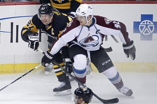 Pittsburgh Penguins' Sidney Crosby (87) works against Colorado Avalanche's Gabriel Landeskog (92) during the first period of an NHL hockey game in Pittsburgh on Thursday, Dec. 18, 2014. (AP Photo/Gene J. Puskar)
