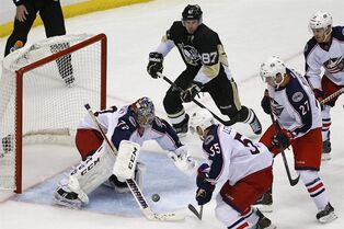 Columbus Blue Jackets goalie Sergei Bobrovsky (72) grabs a rebound on a shot by Pittsburgh Penguins' Sidney Crosby (87) in the first overtime period of a first-round NHL playoff hockey game in Pittsburgh, Saturday, April 19, 2014. (AP Photo/Gene J. Puskar)
