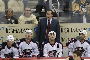 Columbus Blue Jackets coach Todd Richards stands behind his bench in the third period of a first-round NHL playoff hockey game against the Pittsburgh Penguins in Pittsburgh on Wednesday, April 16, 2014. The Penguins won 4-3. (AP Photo/Gene J. Puskar)
