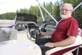 Ken Reddig on the Winnipeg River in his pontoon boat. He kept his secret about being raped in childhood by a minister for decades.