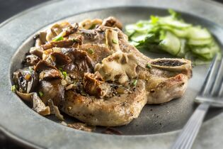 Golden pork chops smothered in sauteed chanterelles and accompanied by a simple and quick cucumber salad are a delicious way to use mushrooms this fall.