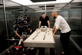 Garland, left, with Oscar Isaac in Ex Machina , a comparatively low-budget ($16 million) movie with just three significant speaking parts, one significant setting and modestly elegant (though still unsettling) visual effects.