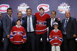 Nikita Scherbak stands with Montreal Canadiens officials after being chosen 26th overall during the first round of the NHL hockey draft, Friday, June 27, 2014, in Philadelphia.The Canadiens have signed Scherbak to a three-year entry-level contract. THE CANADIAN PRESS/AP/Matt Slocum