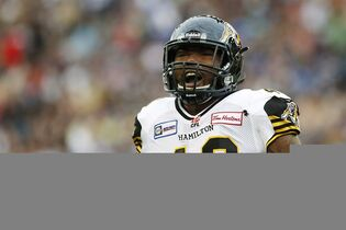 Hamilton Tiger-Cats' Eric Norwood (40) celebrates a tackle on a Winnipeg Blue Bomber during the first half of CFL action in Winnipeg, Saturday, September 27, 2014. The Tiger-Cats have signed international defensive end Norwood to a contract extension through the 2016 season.THE CANADIAN PRESS/John Woods