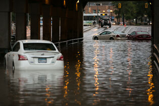 Abandoned cars at the flooded underpass at Higgins and Main Street around 8pm Thursday night.